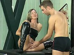 Fetish mom in high boots gets nailed by young dude