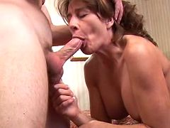 Sexy mom with big tits polishes yummy sausage