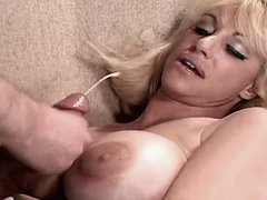 Busty mature gets cumshot on tits