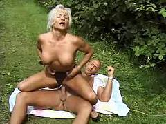 Mature lady with big tits likes to fuck in nature